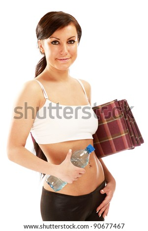 A young sportive girl with a bottle of water and a mat , isolated on white background