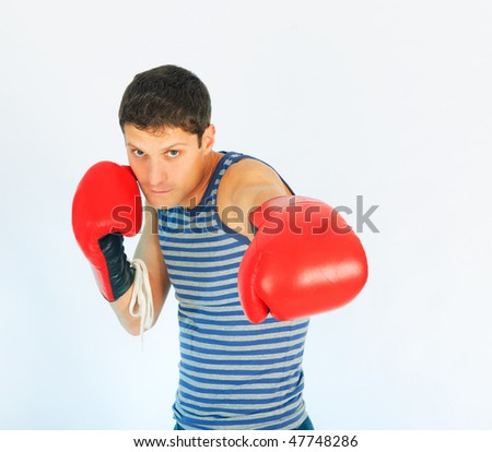 A young sporty men in a red boxing gloves