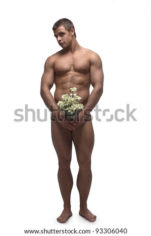 A young strong muscular man with a bouquet of flowers in his hands