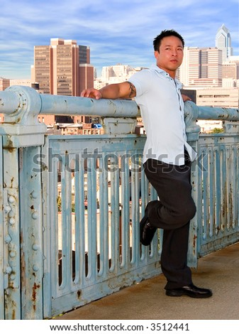 A young successful man overlooking the big city - stock photo