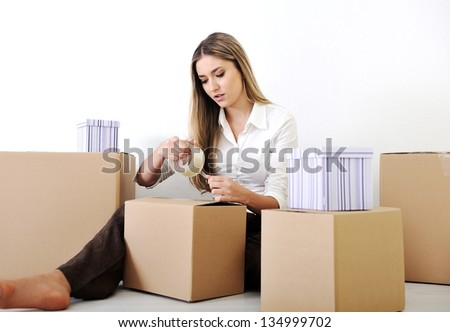 A young teen woman with her luggage and belongings moving home - stock photo