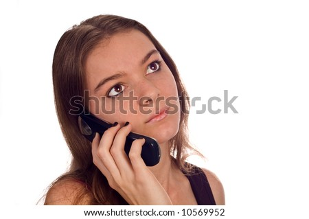 A young teenage female model is on the cell phone.