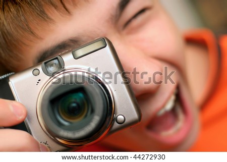 A young teenager gets ready to take a photograph - stock photo