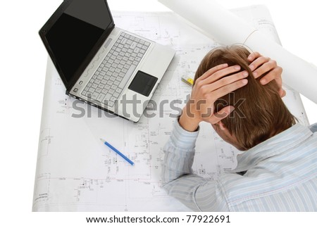 A young tired architect at his workplace, from above - stock photo
