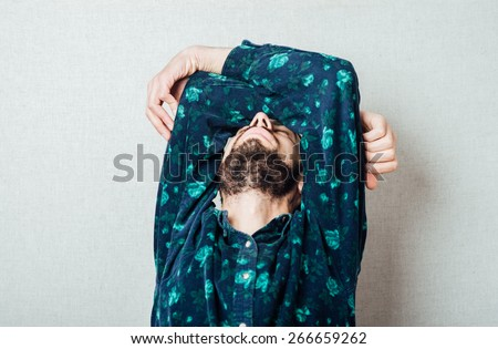 A young tired man close-up  on a gray background . The guy wants to sleep. Gesture. Photos - stock photo