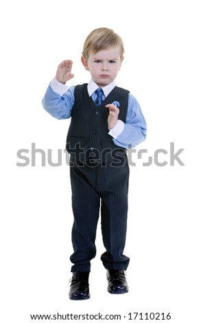 A young toddler boy pretending to be a kung fu expert