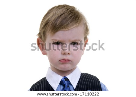 A young toddler boy with a big frown on his face. - stock photo