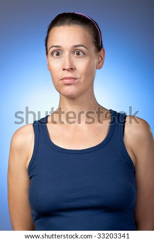 A young woman animatedly making comical faces. - stock photo
