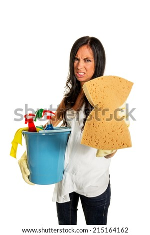 a young woman annoyed that they have to do the house cleaning. - stock photo