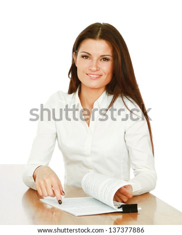 A young woman at the desk with papers, isolated on white background - stock photo