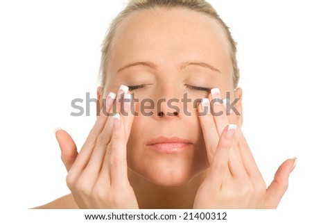 a young woman creaming her face