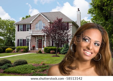 A young woman dreams of owning her own home. - stock photo
