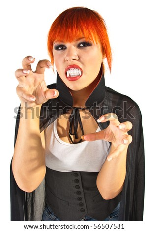 A young woman dressed as a vampire - stock photo
