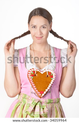 A young woman dressed in a traditional Bavarian Dirndl. - stock photo