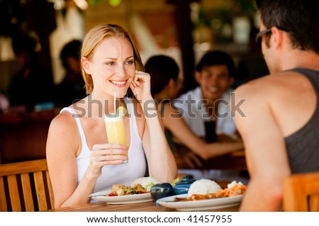 A young woman enjoying lunch at a restaurant