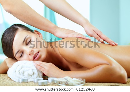 A young woman enjoying spinal massage - stock photo