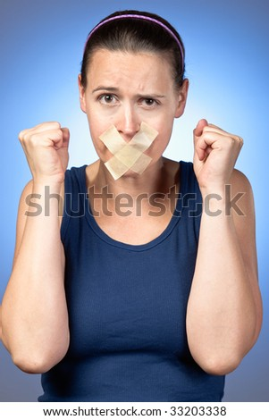 A young woman frustrated at being silenced. - stock photo