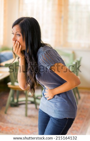 a young woman has abdominal pain - stock photo