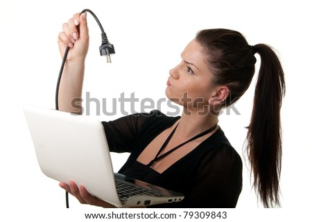 a young woman holding a notebook looking at a power cord - stock photo
