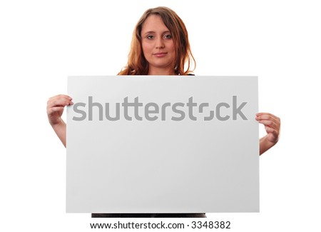 A young woman holding a piece of card isolated on a white background - stock photo
