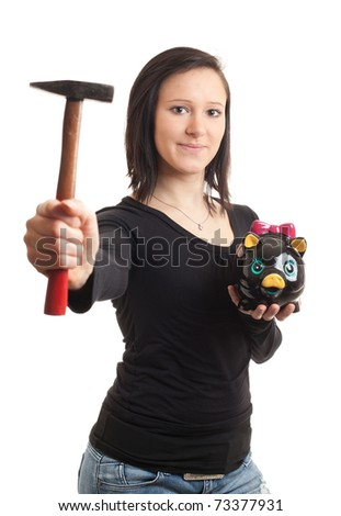 a young woman holding a piggy bank and a hammer isolated on white - stock photo