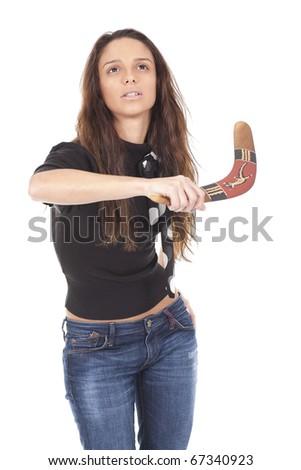 a young woman holding an original australian boomerang - stock photo