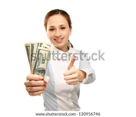 A young woman holding money and showing ok, isolated on white background