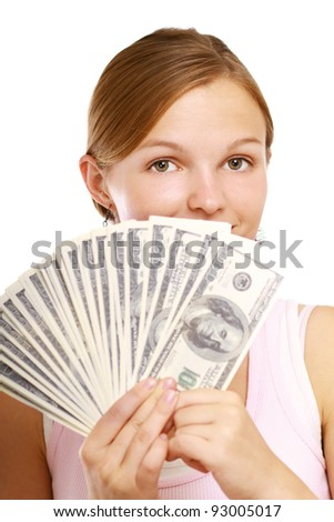 A young woman holding money , isolated on white background