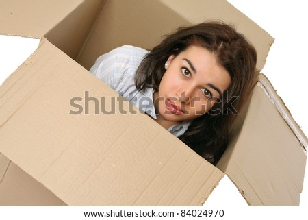 A young woman in a box, isolated on white. Top view