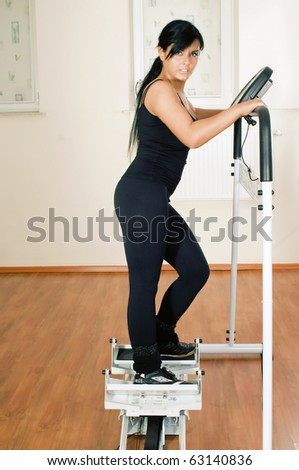 A young woman in a gym