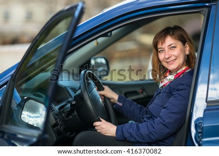A young woman in his new car. - stock photo