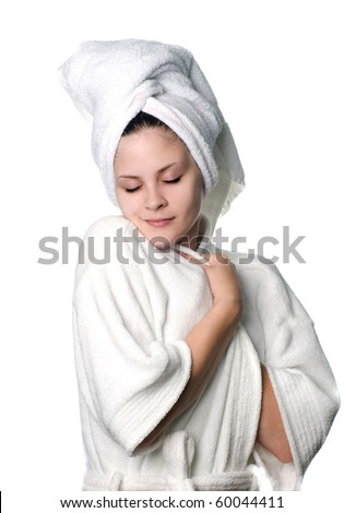 A young woman in white towel and robe after a shower. - stock photo