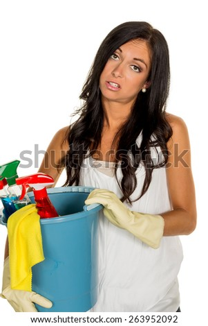 a young woman is annoyed that she has to make the house cleaning. - stock photo