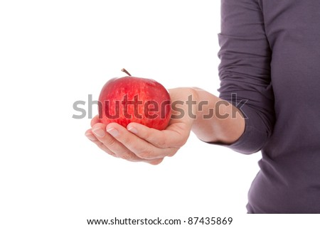 A young woman is holding apples in her hand