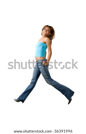 A young woman jumping on a white background. - stock photo