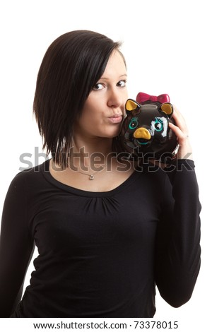 a young woman kissing a piggy bank on her shoulder isolated on white - stock photo