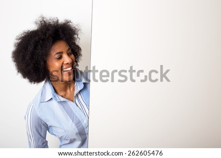 a young woman looking at a blank board with copy-space - stock photo