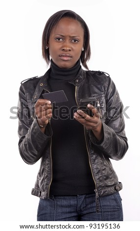 A young woman looks depressed after checking her bank balance on her mobile phone. - stock photo