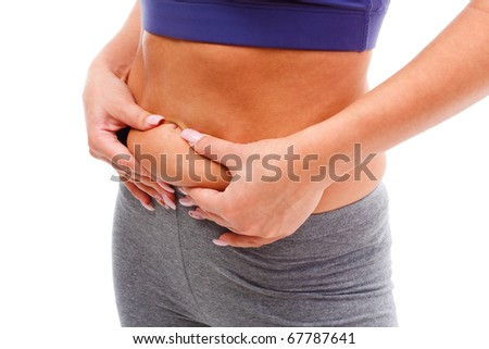 A young woman measuring her weight gain isolated on white. - stock photo