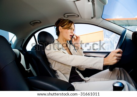 a young woman phoning in the car