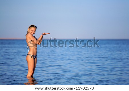 A young woman playing in the ocean. This is the Red Sea in Egypt.