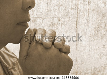 A young woman praying alone with God  - stock photo