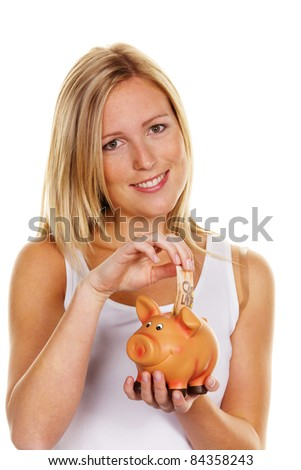 A young woman saves money and coins for the future. Care and save ââ??¬ bill - stock photo