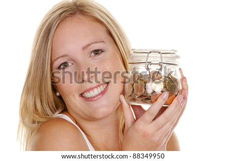 a young woman saves money and coins for the future. preparedness and save. - stock photo
