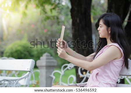 A young woman selfie in the garden