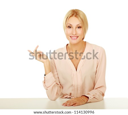 A young woman sitting at the desk , isolated on white background
