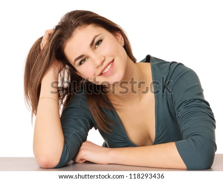 A young woman sitting isolated on white background - stock photo