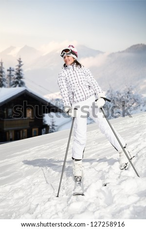 A young woman skiing in the Alps. An outdoor shoot.