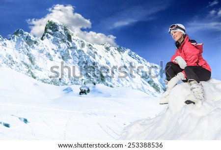 A young woman skiing in the mountains - stock photo