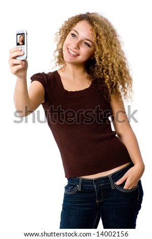 A young woman taking her self-portrait with a camera phone - stock photo